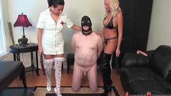 Flaxen-haired and brunette femdom of two male slaves