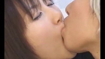 Japanese Lesbian Schoolgirl Giving a kiss Another Girl in Drag