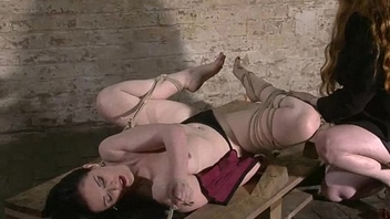 American fetish model Caroline Pierce tied up and hogtied bondage of kinky rope