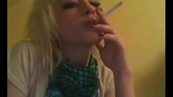 Cute girl smoking cigarette and playing video game